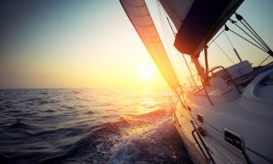 Sail,Boat,Gliding,In,Open,Sea,At,Sunset